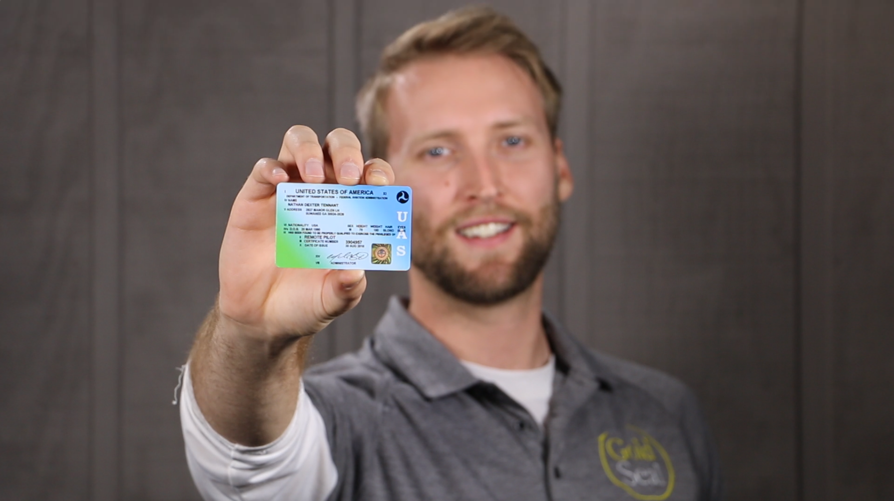 Nate Tennant of Gold Seal's UAVGroundSchool shows off his FAA Part 107 license.